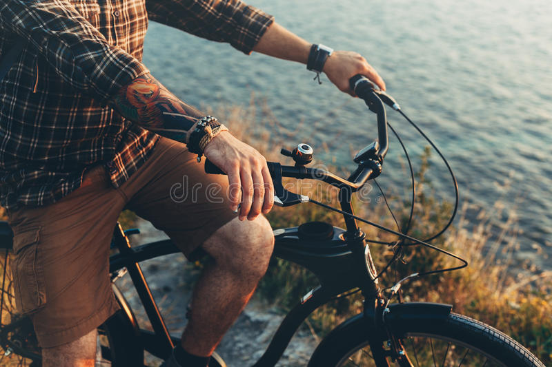 Unrecognizable Young Man Standing With Bike On Coast And Enjoying View of Nature Sunset Vacation Traveling Relaxation Resting Conc stock photography