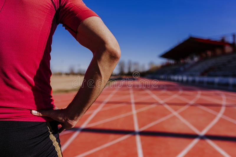 Unrecognizable young runner man in the athletics lane. Sports outdoors stock photos