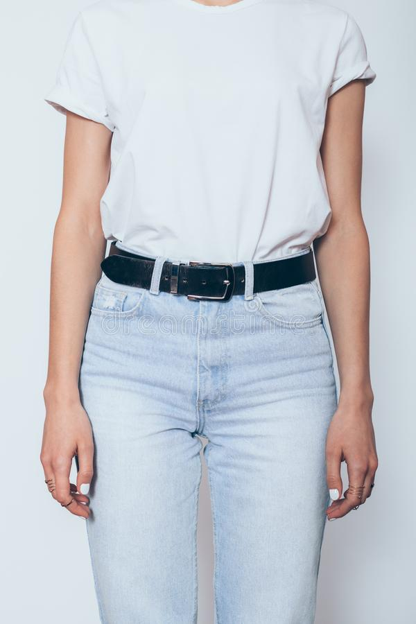 Unrecognizable young woman wearing blanc white t-shirt stock photography