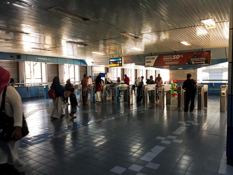 Unrecognized people. a crowd of people lining up the Jakarta city train station. JAKARTA, INDONESIA, 02/2019. N stock photo