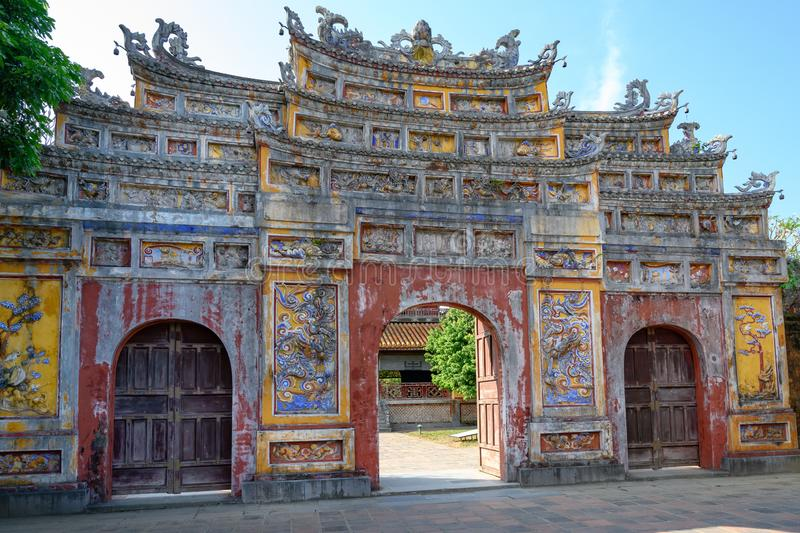 Unrestored ancient gate of Imperial City Hue, Vietnam. Gate of the Forbidden City of Hue. royalty free stock photo