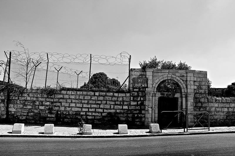 UNRWA. Ominous and neglected looking UNRWA building opposite the Old City in Jerusalem, giving a stark irony to 'relief royalty free stock image