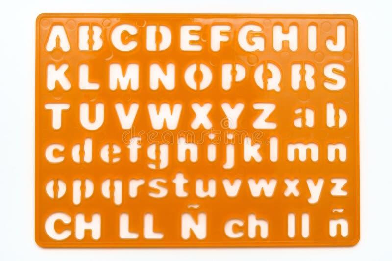 Uns artigos de papelaria coloridos alaranjados do molde dos alfabetos das letras fotografia de stock royalty free