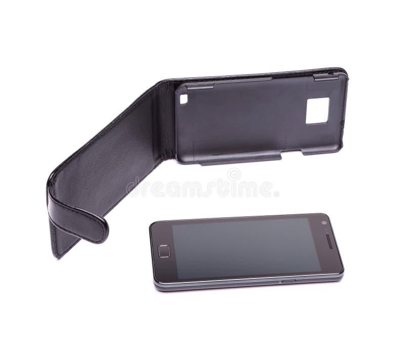 Uns móbil e caso modernos no fundo branco fotos de stock