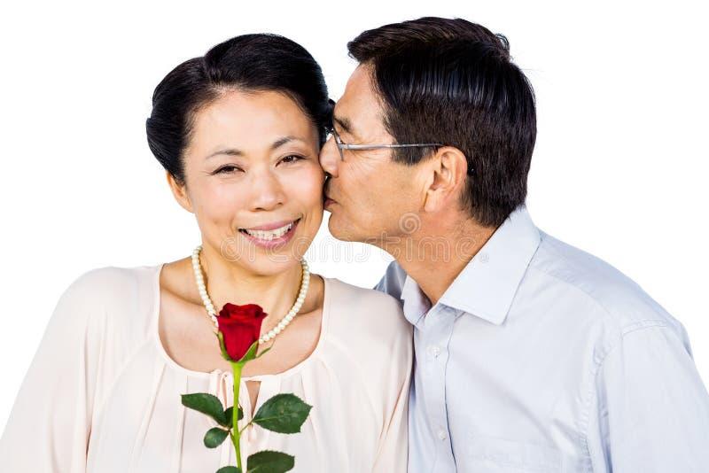 Uns pares asiáticos mais velhos com aumentaram fotografia de stock