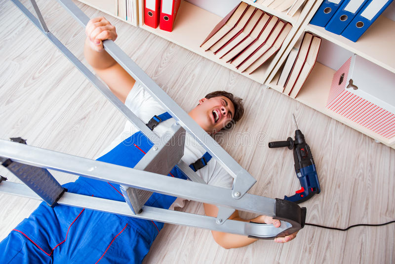 The unsafe behavior concept with falling worker stock image