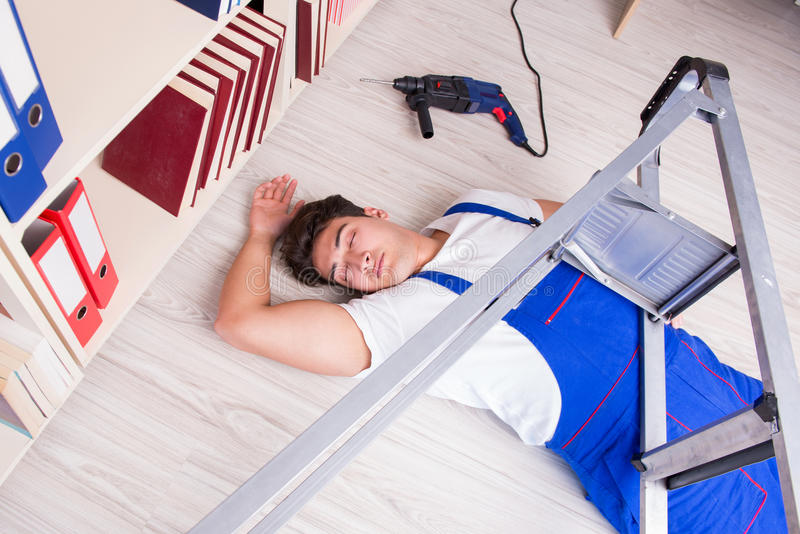 The unsafe behavior concept with falling worker. Unsafe behavior concept with falling worker stock image