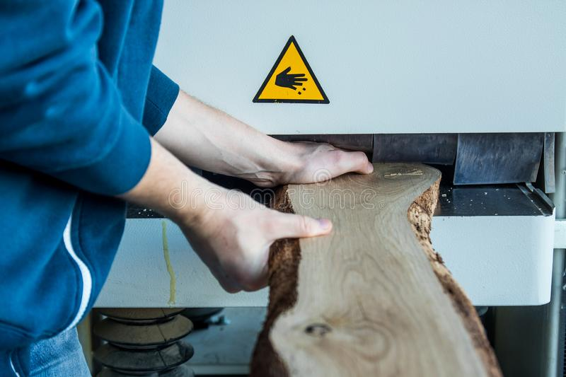 Unsafe working with wood machine. An unsafe work environment occurs when an employee is unable to perform her required daily duties because the physical stock image