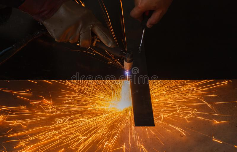 Unsafe work - Using plasma cutting machine. Unsafe work - Using plasma cutting machine without safety protection stock photography