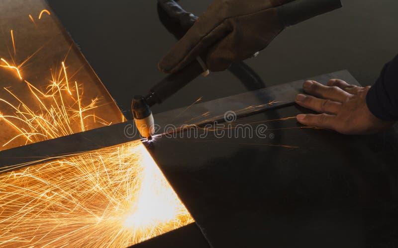 Unsafe work - Using plasma cutting machine. Unsafe work - Using plasma cutting machine without safety protection royalty free stock photos