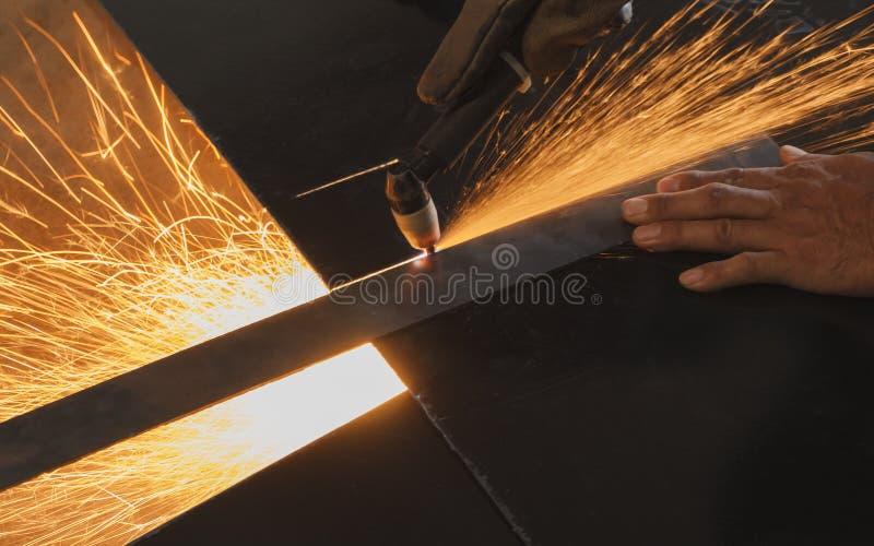 Unsafe work - Using plasma cutting machine. Unsafe work - Using plasma cutting machine without safety protection. Steel fabrication process royalty free stock photos
