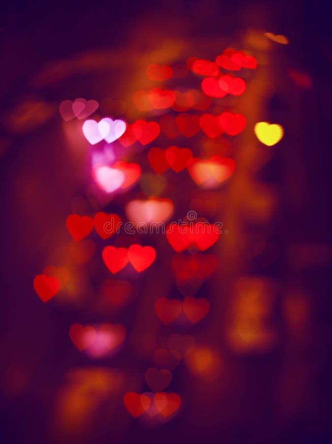 Unscharfe Unfocussed Mehrfarbenlichter in Form des Herzens lizenzfreie stockbilder