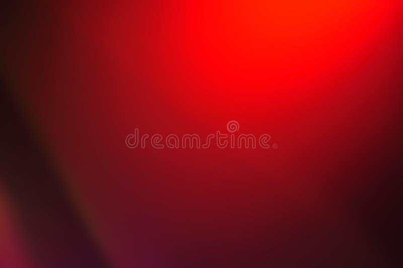 Unscharfe Zusammenfassung dunkelrot mit hellem Hintergrund Rote, kastanienbraune und schwarze Farbeleganz, glatter Hintergrund od stockfotografie