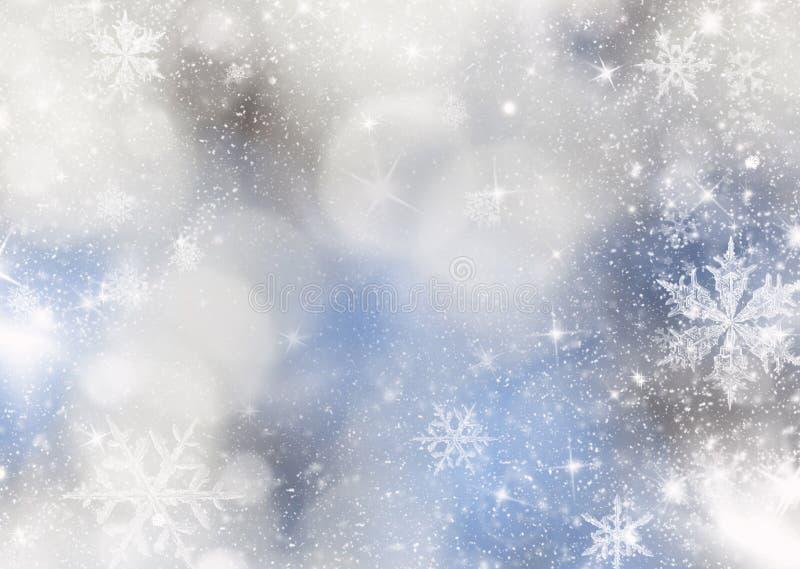 unscharfer bokeh Hintergrund von Weihnachtslichtern und -schneeflocken stockfoto