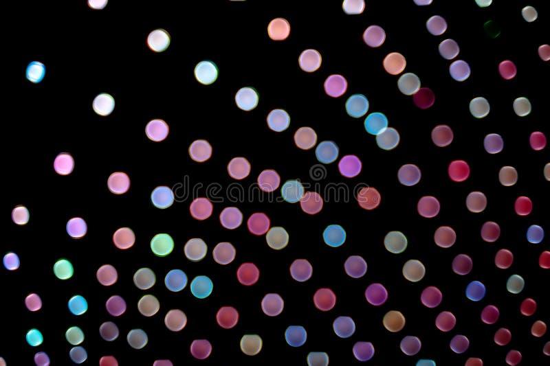 Unscharfer Lichthintergrund mit farbigen Kreisen lizenzfreie stockfotografie