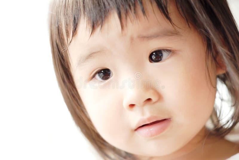 Unschuldiges asiatisches Schätzchengesicht lizenzfreies stockbild