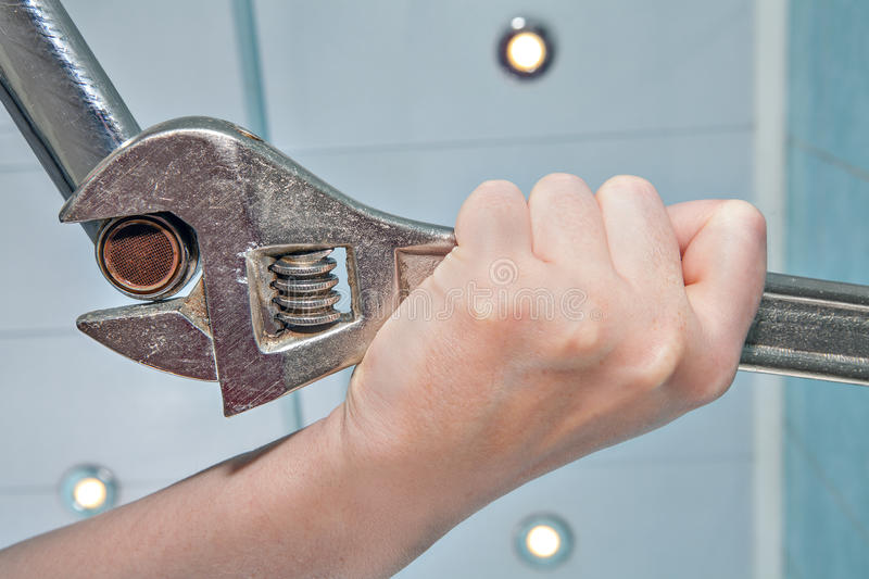 Unscrew the old faulty, clogged tap aerator, hands plumber close. Unscrew the old wrong, clogged faucet aerator, using an adjustable wrench plumber, hands stock photos