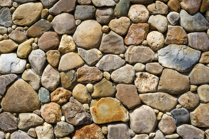 Unshaped stones wall texture royalty free stock image