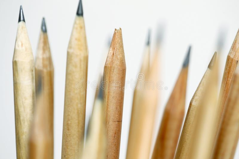 Unsharpened pencil in focus on beam of natural wood pencils stock images