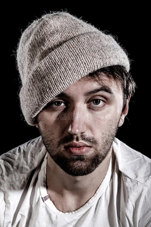 Unshaven man in a knitted hat royalty free stock photo