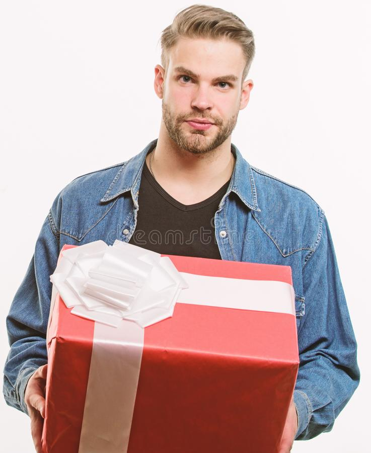 Unshaven man with present box. Happy birthday. Man share present. Romantic greeting. Boxing day. Handsome macho man. Love date. Valentines day gift. Male stock photo