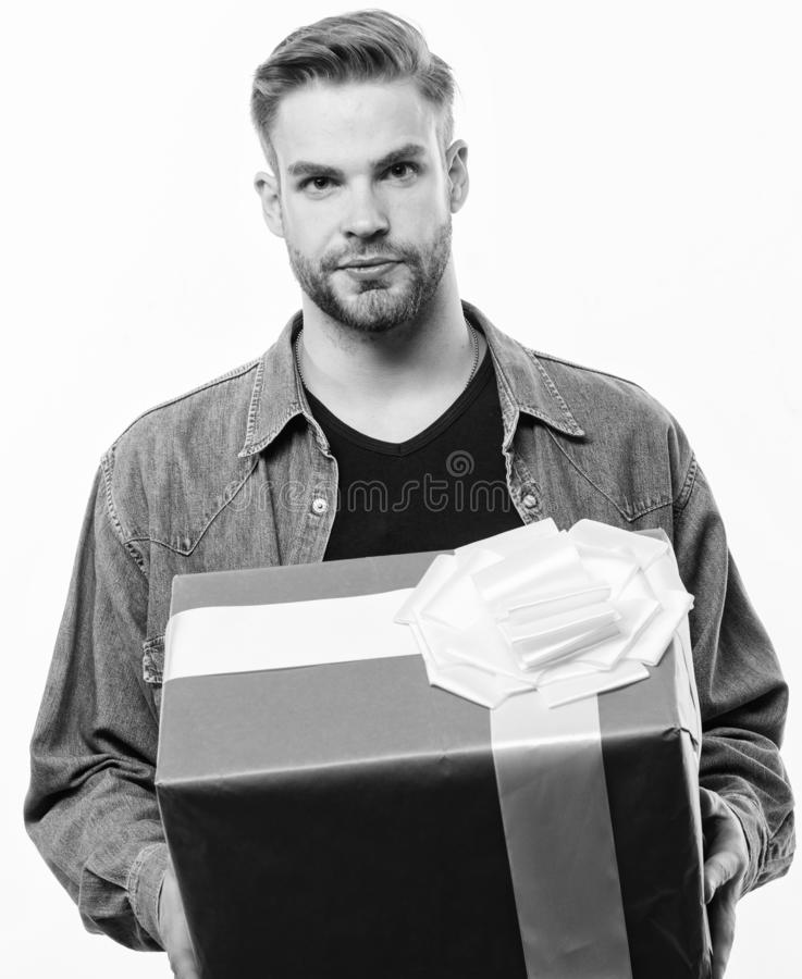 Unshaven man with present box. Happy birthday. Man share present. Romantic greeting. Boxing day. Handsome macho man. Love date. Valentines day gift. Male royalty free stock image