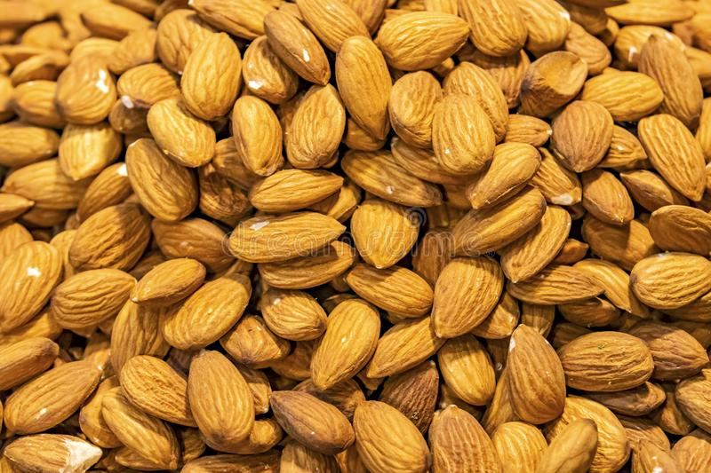 Unshelled almonds in bulk stock images