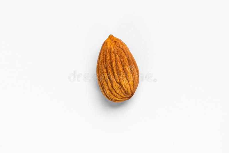 Unshelled almonds lie in the center on a white background royalty free stock photos