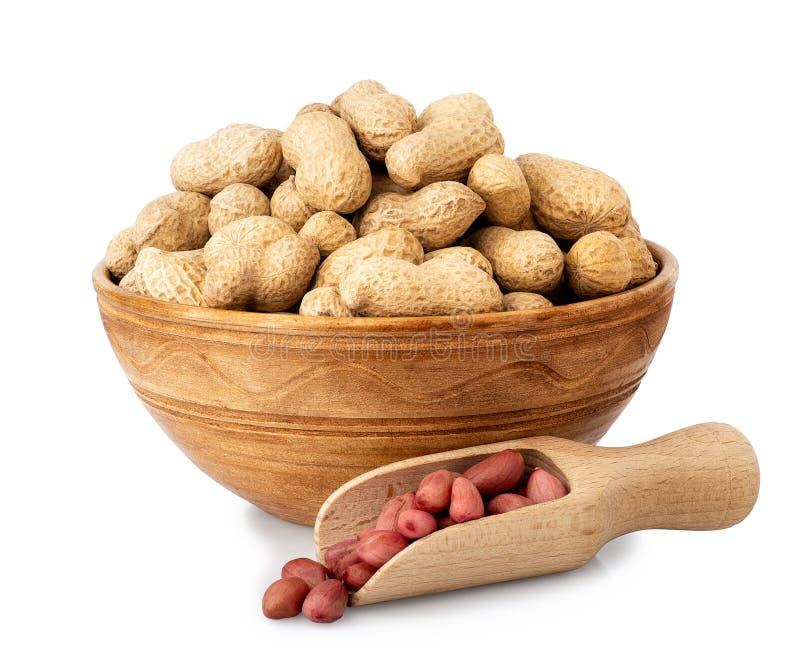Unshelled jordnötter i bunke arkivfoto