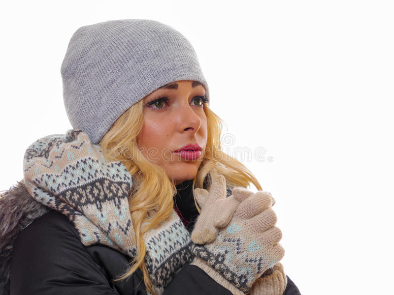 Unsmiling woman dressed for winter. stock images