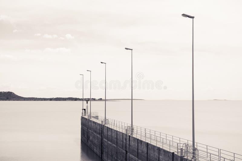 Unsplash.com – Water Ocean Pier Dock Light Pole Sky royalty free stock image