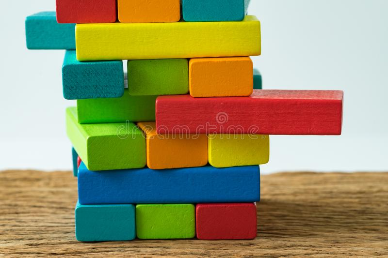 Unstable colorful wooden block tower as Risk or stability concept.  royalty free stock photo