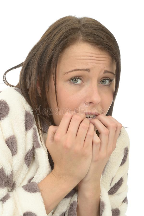 Unstable Nervous Scared Anxious Young Woman Looking Unhappy. Unstable Nervous Frightened anxious or scared Young Woman In Her Twenties, looking at camera Biting royalty free stock images