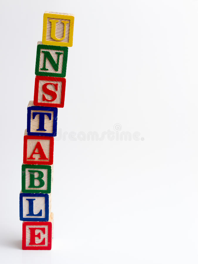 Unstable tower of blocks stock photos