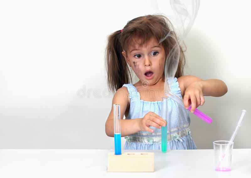 Unsuccessful chemical experiment. Dirty child making unsuccessful chemical experiment stock photography