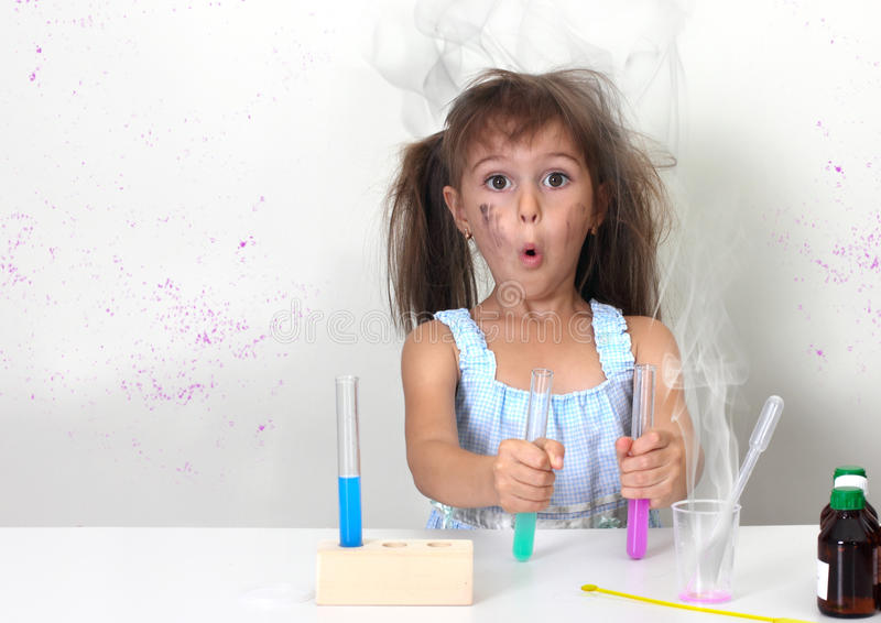 Unsuccessful explosive chemical experiment. Dirty child making unsuccessful explosive chemical experiment royalty free stock photos