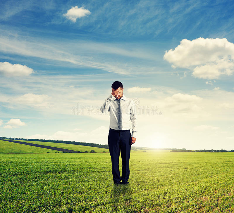 Free Unsuccessful Man Standing On The Field Royalty Free Stock Photography - 33652427