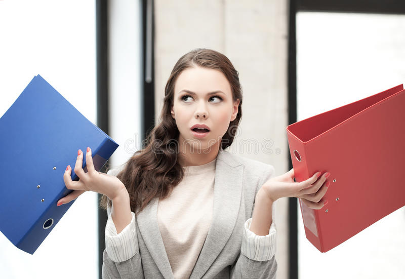 Unsure thinking or wondering woman with folder royalty free stock image