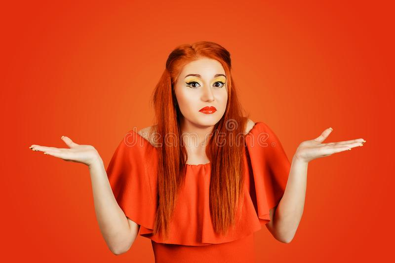 Unsure woman gesturing do not know sign on red background stock image