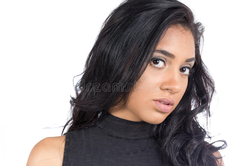 Unsure of a young black woman. Female model wearing black clothe stock image