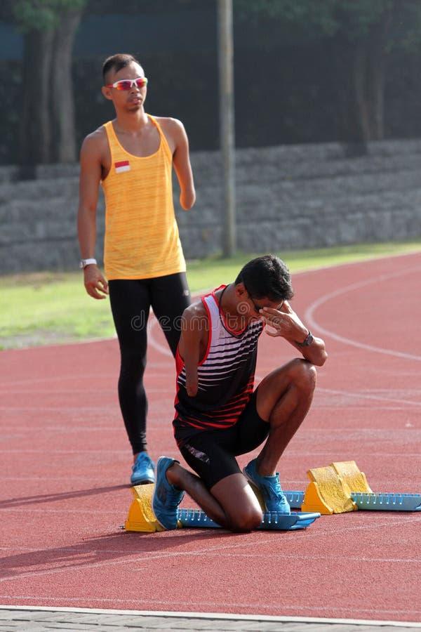 Untaugliche Athleten stockbild
