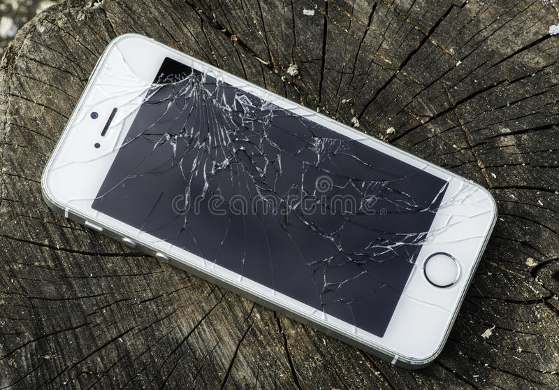Unterbrochenes iphone lizenzfreie stockfotografie