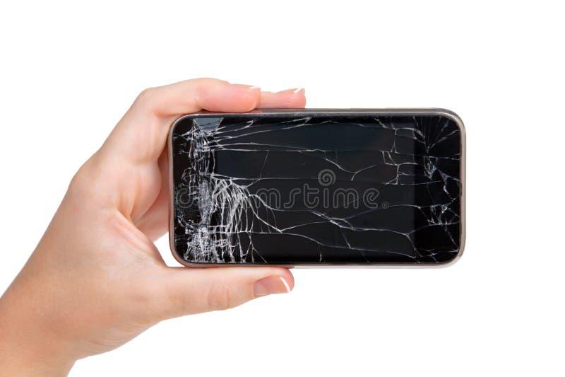 Unterbrochenes Telefon in einer Hand lizenzfreie stockfotos