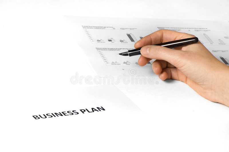 Unternehmensplan mit der Hand + Feder stockbild