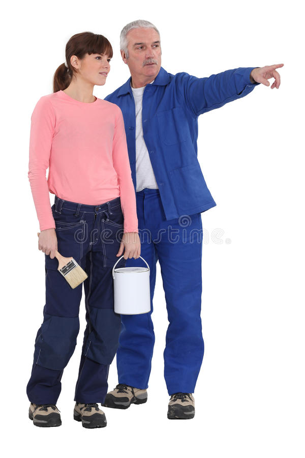 Unterrichtende Tochter, wie man verziert lizenzfreie stockfotos