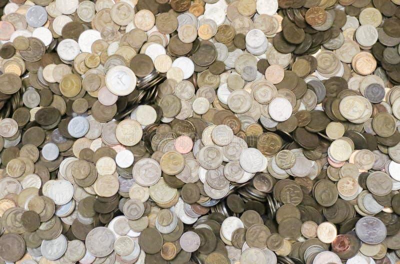 Unterschiedlicher Münzenhintergrund lizenzfreie stockfotos