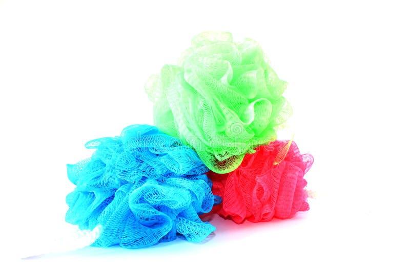 Unterschiedliches farbiges Loofahs lizenzfreies stockbild