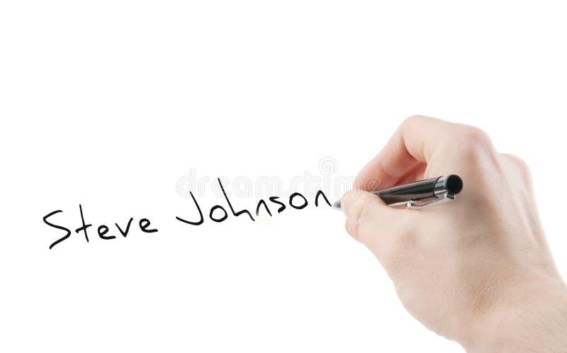 Unterschrift und Hand mit dem Stift lokalisiert auf Weiß lizenzfreie stockfotos