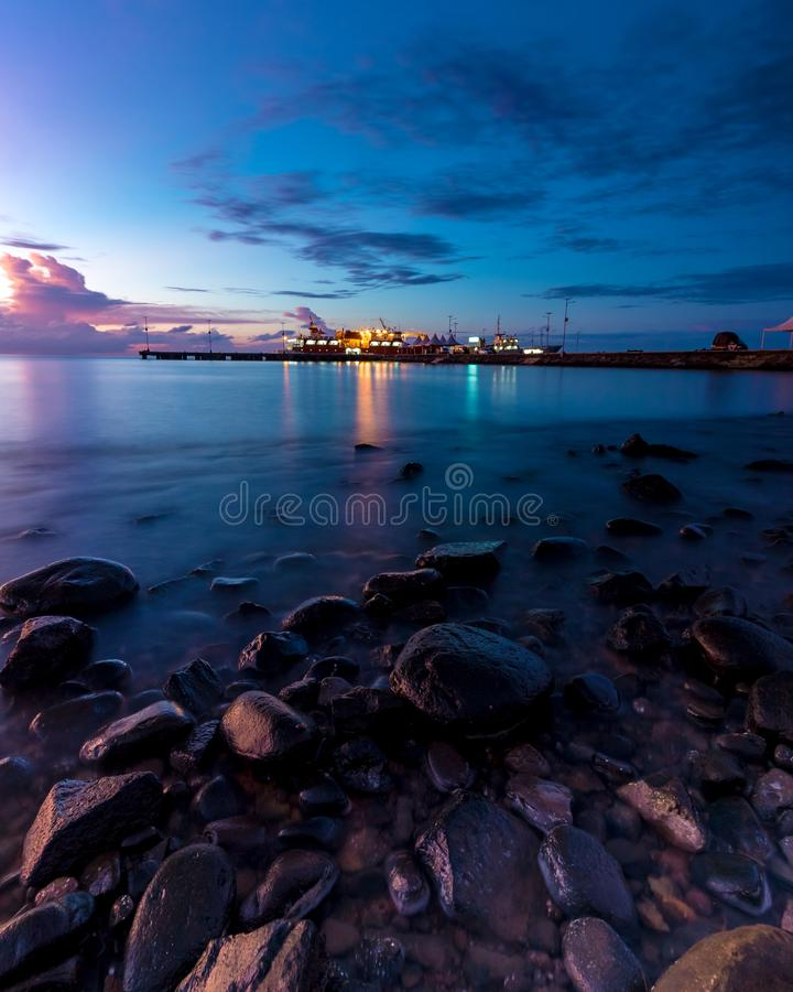 Blue hour at Untia Harbour Makassar stock photography