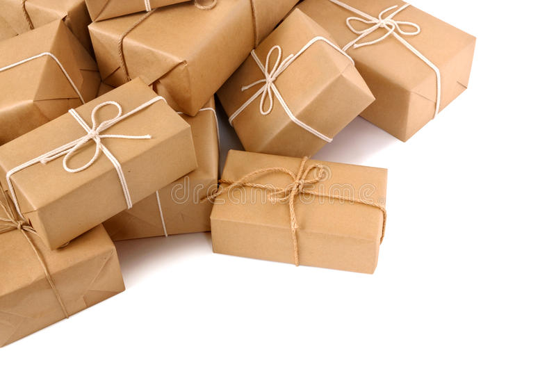 Untidy pile of brown paper packages isolated on white stock images